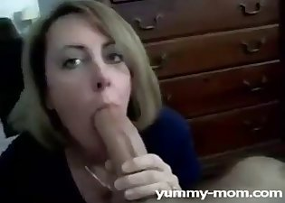 Beautiful mommy is sucking down on the knees