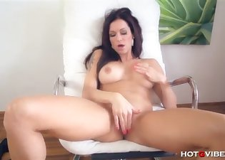 Angelic busty brunette stimulates her cunt