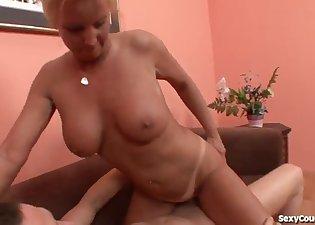 Spicy busty MILF fucked by a big boner