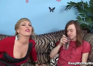 Young man pounds with a big-boobed MILF