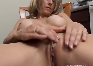 Fake-tit mommy is playing with her snatch