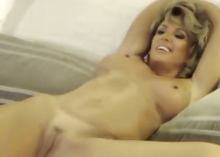 Kinky MILF with big tits plays with her hole