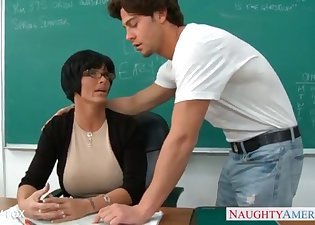 Brunette teacher is getting fucked by a stud