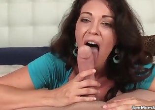 Big-boobed brunette sucks and jerks a dick