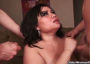 Asian brunette is sucking two big cocks