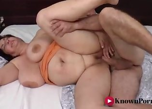 The busty lady opens her crack for a long dick