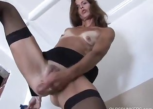 Seductive angel is fucking with a sex toy