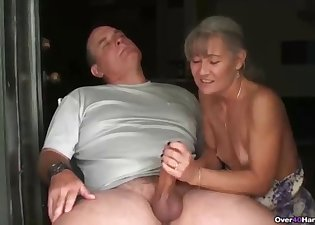 Cute lady strokes his huge wiener