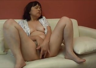 Soloing mature rubs her soft snatch