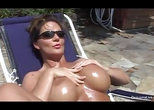 Sex goddess shows off her big melons