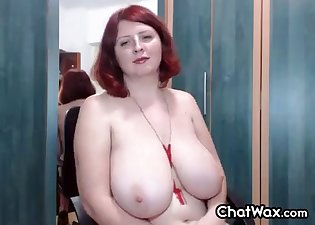 Busty redhead BBW presents her naked body