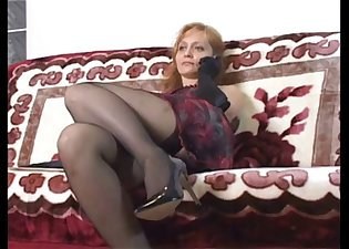 Redhead in nylons strokes his sausage